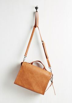 Express Train of Thought Bag. Meet your commute with calm knowing that everything you need for a busy day fits in this cognac crossbody bag. #brown #modcloth
