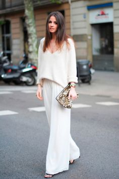 white and loose clothes with the oversized shiny clutch. love.
