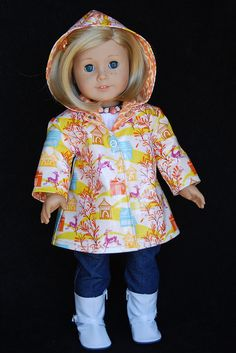 Meg (norasroom) sent me this awesome laminated fabric to try. I thought it was so cute and the perfect scale for an American girl doll raincoat. I loved working with the laminate except the topstitching part. That was a bit tricky, but next time I try it, I'll have the proper foot for my machine! Thank you so much Meg, and Kit thanks you too!