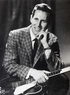 Chet Atkins (June 20, 1924 - June 30, 2001) American musician, songwriter and producer.