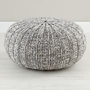 If you need additional flexible seating in the room, I'd consider 1 or 2 of these knit poufs. The grey will add a nice neutral and the texture is really great in the space.
