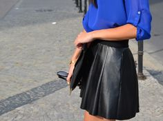 royal blue top, leather skirt