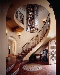 Lovely staircase - the medallion and matching tiles along with the wrought iron chandelier are the perfect accents.