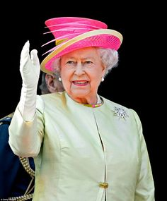 Still going strong: Queen Elizabeth II waves after watching a flypast of Spitfire and Hurricane aircraft from the balcony of Buckingham Palace to commemorate the 75th Anniversary of The Battle of Britain on July 10, 2015