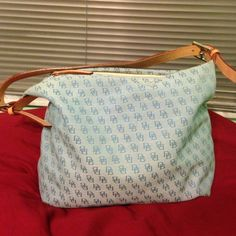 Dooney and Bourke Baby blue purse Good condition D&K purse, minor scratches on the leather strap and inside pocket Dooney & Bourke Bags Shoulder Bags
