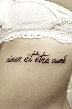"""aimer et être aimé"", this means ""love and be loved"""