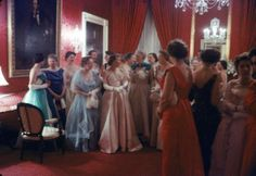 Mrs. Earl Warren (front row, L) listening to 1st Lady Mamie Eisenhower (front row 2L, in pink) entertaining guests at a State Dinner.Locatio...