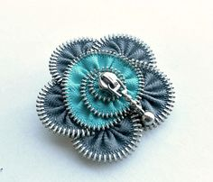 Flower Brooch , Zipper Pin. YKK Zipper , eco friendly, size  Approx 2,6 in/ 6,5 cm.- gray and cyan, recycled jewelry. $19.00, via Etsy.