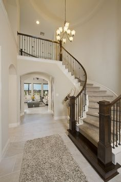 Valencia by Perry Homes Model Home - 4,192 Sq. Ft. - Foyer & Grand Staircase - #PerryHomes #ValenciabyPerryHomes #Richmond #FortBendCounty #Houston #HoustonHomes #trustedbuilder #homedecor #homedesign #mediterraneanstyle #courtyards #courtyardhome #moderndecor #modernhomedesign #foyer #grandstaircase #stairs #stairway #familyroom #wallofwindows