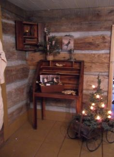Love the little tree in the old little wagon!!!a little close to the side wall but ever so cute great idea
