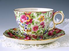 Lovely Royal Winton English bone china Summertime chintz teacup and saucer. Elegant all-over floral print, even on the handle, over cream background, with pretty gold trim. The cup shape is Raleigh footed. The set has an old logo and dates to pre-1960. This is a beautiful cup and saucer in like-new condition. It would make a very special gift, for yourself or a friend. Standard size.  In gorgeous vintage condition with no chips, cracks, wear or gold loss. ❖ Manufacturer: Royal Winton ❖…