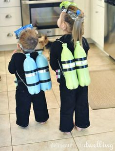 """19 DIY Kids' Halloween Costumes That Are So Cute You'll Want to Cry: READY FOR LIFT OFF. Is your little one ready to explore land, sea, and sky? Two-liter pop bottles become rocket packs with a little spray paint and electrical tape. Or turn them into oxygen tanks for scuba divers by adding snorkel goggles and an all-black """"wetsuit."""" See more at Delineate Your Dwelling."""