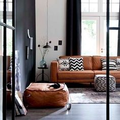 Loving this designer space by @crowdyhouse The earthy tones of that couch & ottoman mixed with the monochrome #perfection