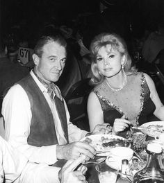Zsa Zsa Gabor and her fifth husband, Joshua S. Cosden, Jr., were photographed at the SHARE Boomtown charity party in 1966.