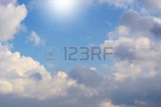Beautiful Clouds In A Bright Blue Sky - White Shining Light From ...