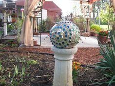 Mosaic bowling ball, with broken mirror.