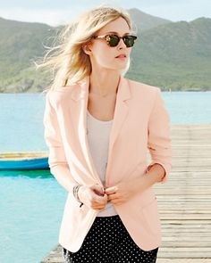 The jacket softens up in whisper-weight silk for a chic spring alternative to a sweater. Slip it over jeans or a sweet little dress and feel instantly pulled together. With a one-button design, notched collar, and patch pockets, this blazer boasts classic styling, with petite shoulder pads (yes, they're back).