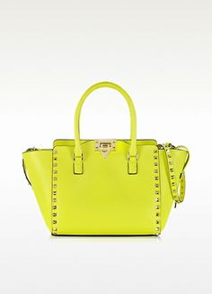 Valentino Garavani Small Rockstud Leather Tote. The Small Rockstud Leather Tote is part of the Valentino Garavani Rockstud Collection. Crafted in luxe leather vibrant colors with Fluo being the highlight of the palate. Featuring zip and flip lock metal closure, double handles, removable studded shoulder strap and platinum finish signature pyramid stud details. Made in Italy. http://www.eu.forzieri.com/handbags/valentino/vo130114-002-00