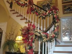 This blog post has many pictures of a beautifully decorated house.  Lots of ideas for garland, trees, and mantels.  Great inspiration!