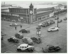 Vintage Baltimore C 1948. The corner of Pratt & Light Street with the Harbor in the background.