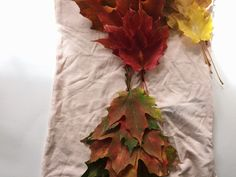 Learn how to make a Mother Nature costume. A dress from fresh leaves, braided and pinned. A simple Halloween costume how to.