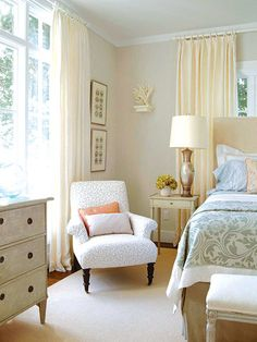 Keep it Calm  The sunny guest bedroom boasts the best views in the house. Given its panorama, the room is kept calm with an old Swedish painted chest and bench, a Victorian nursing chair in a soft pattern and a faux straw-upholstered headboard. Floor-to-ceiling linen curtains tame the light.
