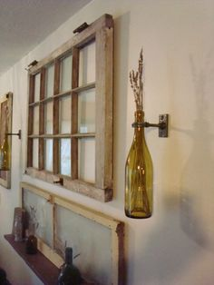 Wine bottle wall vase display with old window/ door. I used this same hanging system for my curtain rods.