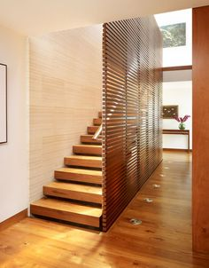 Horizontal wood slat staircase with handrail - for open areas on stairs going up to 2nd level and in the old windows going up to third.
