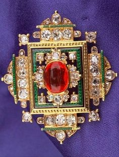 Renaissance Revival Fire Opal, Enamel, and Diamond Brooch, bezel-set with a cushion-cut fire opal measuring approx. 9.80 x 7.45 x 5.33 mm, further set with old mine, old single, and rose-cut diamonds, green enamel highlights, reverse with engraved accents.