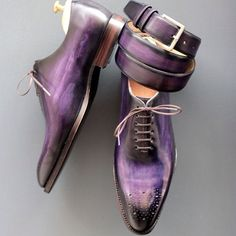 I need some purple shoes with a matching belt now.