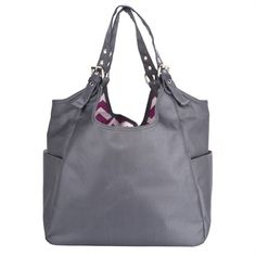 The Graphite Blush Satchel Diaper Bag by JP Lizzy Satchel makes the perfect everyday bag for mom.  The exterior sports a stylish wipeable nylon fabric with a patterned fabric on the inside making this bag truly timeless
