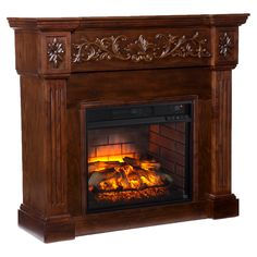 Warm up your home with the delightful life-like embers and classic detailing of the Southern Enterprises Calvert Carved Infrared Electric Fireplace. Embellished with floral woodwork and elegant fluting, this fantastic fireplace warms up to sq. Faux Fireplace Mantels, Wooden Fireplace, Fireplace Screens, Fireplace Tools, Home Fireplace, Fireplaces, Electric Fireplace Heater, Traditional Fireplace, Fireplace Accessories