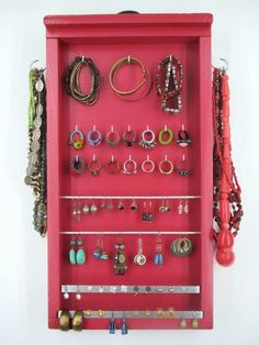 pretty jewelry organizer - I particularly like the dowel that the earrings can be laid over