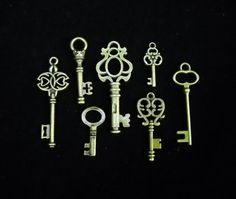 "Multipack 7/8""-1 3/4"" 7 piece Skeleton Keys antique bronze tone vintage antique charm steampunk metal replicas SMALL"