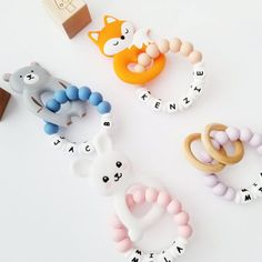 **Please note: wooden clip is out of stock. Clips will come with round metal clip**  Welcome to our shop!  Perfect teething set that comes personalized with their name on silicone beads to soothe your teething baby and stimulate visual, motor, and sensual development. Featuring chemical free all Personalized Gifts For Kids, Customized Gifts, Newborn Baby Gifts, Baby Girl Gifts, Teething Toys, Gifts For Girls, Baby Shower Gifts, New Baby Products, Babies