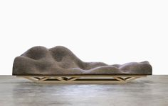 Brain Wave Sofa is a collaboration between Lucas Maassen and Dries Verbruggen from Unfold...a 3 second computerfile is sent to a CNC milling machine that mills out the Brain Wave in soft foam. Cover in grey felt.