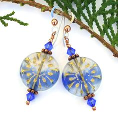 You could never have the blues when you wear the always cheerful DON'T HAVE THE BLUES handmade starburst flower earrings. Captivating Czech glass floral beads, sparkling sapphire blue Swarovski crystals, copper and sterling silver were brought together make a pair of one of a kind earrings that you will want to wear time and time again.