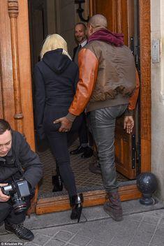 Kim Kardashian swaps her eye-popping attire for casual hoodie #dailymail