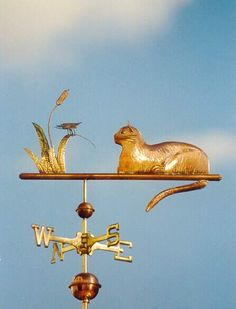 Cat with Butterfly Weathervane by West Coast Weather Vanes.  This all copper handcrafted cat weathervane was customized using glass eyes and brass whiskers.  The butterfly sits atop a brass cat tail plant.