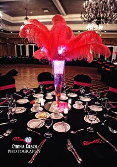 Black and neon bat mitzvah with feather plume centerpieces.