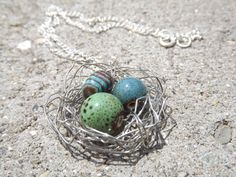 $23 - www.etsy.com/shop/JustHeathersJewelry - Bird's nest necklace - crinkled wire wrapped - blue, green, brown beads and stones - birdnest - robins egg nest - ceramic - gift idea. Use coupon code PINS15 for 15% off your total purchase.