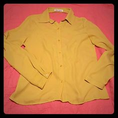 Yellow blouse Beautiful yellow color with a sexy back. Only worn once, bought at a local boutique. Size large. Make reasonable offers. Moving soon, need gone. Tops Blouses