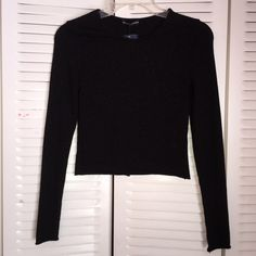 Brandy Melville Sparkly Top Brand new with tags, one size Brandy Melville Sweaters