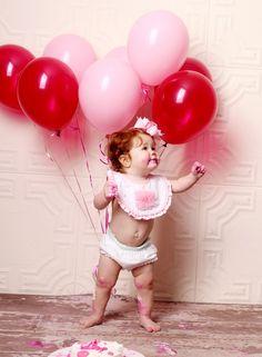1st Birthday Photo Shoot! I like that she has a bib on. Cute idea.