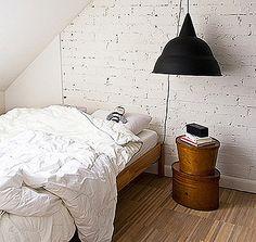 black, white, wood, exposed brick, attic bedroom
