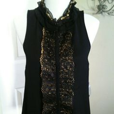 Sleeveless black and gold blouse Sheer chiffon -like material with gold lace accents down front and around neckline. Snaps up front are covered and hidden inside the seam. Very nice for either casual with jeans or dressy with trousers or skirt. Jennifer Lopez Tops Blouses