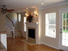 Another gorgeous look of the family room. New mantel, lighting, windows & door.