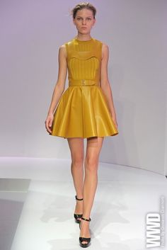 Yellow leather skater dress.