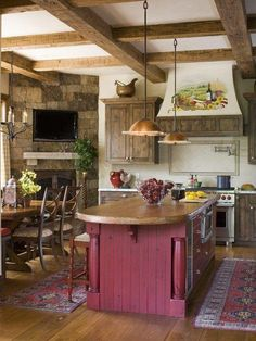 I really like this Kitchen with deep red painted cabinets,wood floors and room for a real Stove.
