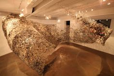 constructed from newspaper and magazine by New York-based artist Yun-Woo Choi. Found at Elemeno P